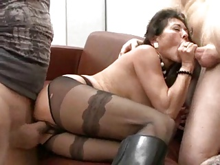 Hairy German Granny In Boots Takes Two Cocks